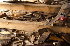 Saw with sawdust and pieces of wood. Saw with sawdust and pieces of wood Royalty Free Stock Photo