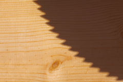 Saw Shadow. Shadow of saw blade on wodden board Stock Images