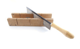 Saw with wood Stock Images