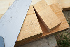 Saw and wooden boards Stock Image