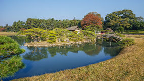 Sawa-no-ike Pond at Korakue-en garden in Okayama. Located in the center of the garden with Shima-Jaya Teahouse on Naka-no-Shima island Royalty Free Stock Photos