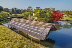 Sawa-no-ike Pond at Korakue-en garden in Okayama. Located in the center of the garden with Shima-Jaya Teahouse on Naka-no-Shima island Stock Photography