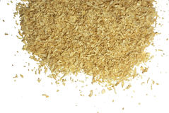 Sawdust. A pile of wood shavings on a white background Royalty Free Stock Images
