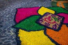 Sawdust alfombra for Semana Santa on cobbled street, Antigua, Guatemala. Sawdust alfombra with flower design for Semana Santa on cobbled street, Antigua royalty free stock image