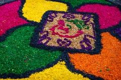 Sawdust alfombra for Semana Santa, Antigua, Guatemala. Sawdust alfombra with flower design for Semana Santa, Antigua, Guatemala royalty free stock photo