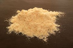 Sawdust. Heap on brown table royalty free stock images