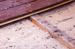 Sawdust insulation under old floor boards. Sawdust insulation under floor boards show some depression (sagging) over time Royalty Free Stock Image