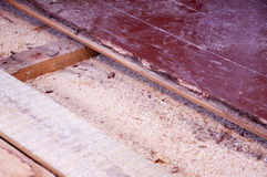 Sawdust insulation under old floor boards. Sawdust insulation under floor boards show some depression (sagging) over time Royalty Free Stock Images