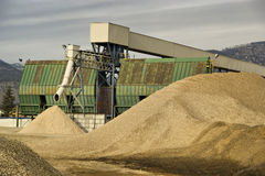 Sawdust Mill. A pulp mill churns out sawdust as a by-product royalty free stock photography