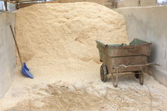 Sawdust ready to be used to dry the stables Royalty Free Stock Image