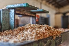 Sawdust resulting from the cutting of wood. Industry royalty free stock photography