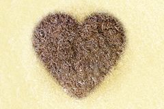 Sawdust in the shape of a heart, sunlight. stock image