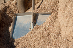 Sawdust and shovel Stock Photos
