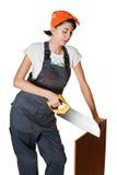 sawing девушки доски Стоковое Изображение RF