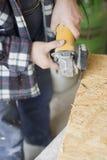 sawing доски деревянный Стоковое фото RF
