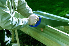 Sawing. Carpenter using a saw royalty free stock photo
