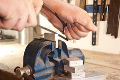 Sawing in a block of metal Stock Photo
