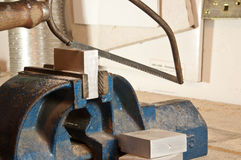 Sawing in a block of metal Stock Photos