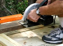 Sawing the Board Royalty Free Stock Photography