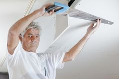 Sawing into the ceiling. Blade stock photography