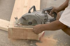Sawing joist. At new house Stock Photo