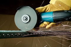 Sawing metal Stock Images