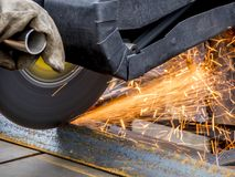 Sawing of metal. Sawing a metal with an abrasive wheel Royalty Free Stock Image
