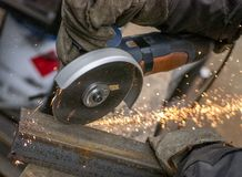 Sawing of metal. Sawing a metal with an abrasive wheel Royalty Free Stock Photography