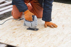 Sawing OSB Royalty Free Stock Photography