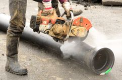 Sawing Pipe Stock Images
