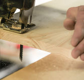 Sawing with a reciprocating saw Royalty Free Stock Photography