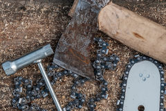 Sawing trees. Tools for cutting trees. Bus chainsaw, axe chain Stock Photos
