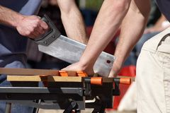 Sawing Wood. Carpenters sawing wood Stock Photo