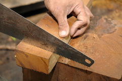 Sawing a wood royalty free stock photography
