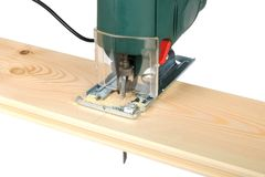 Sawing wood board Royalty Free Stock Image