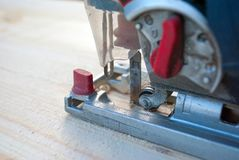 Sawing wood with a jigsaw. Horizontal photo Stock Photo