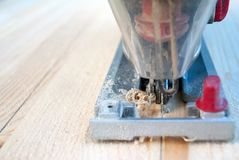 Sawing wood with a jigsaw royalty free stock photos