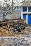 Sawing wood in the yard Royalty Free Stock Photo