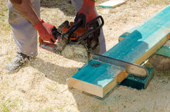 Sawing wooden beam Royalty Free Stock Image