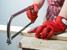 Sawing wooden board composition Stock Photos