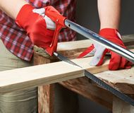 Sawing wooden board composition Stock Photography