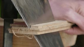 Sawing of wooden plank stock video footage