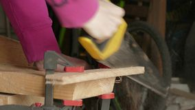 Sawing of wooden plank stock video