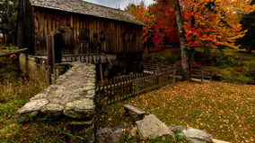 Sawmill antique. Leonards Mill Maine fall autumn colors old fashioned leaves chill orange red yellow season saw wood Stock Images