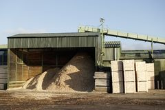 Sawmill factory wood chips hopper and machine cutter. Uk royalty free stock photo