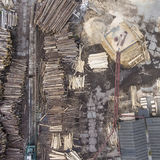 Sawmill. Felled trees, logs stacked in a pile. View from above. Industrial background Stock Photos