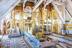 Inside a sawmill. Interior of a sawmill, a facility where logs are cut into lumber or timber, Netherlands Royalty Free Stock Images