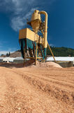 Sawmill plant machine with sawdust everywhere Royalty Free Stock Image