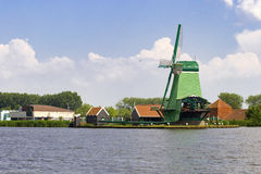 Sawmill at the river side in Zaanse Schans Royalty Free Stock Photos