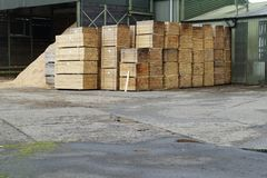 Sawmill stacked wood planks pallets at factory outdoors. Uk royalty free stock photo